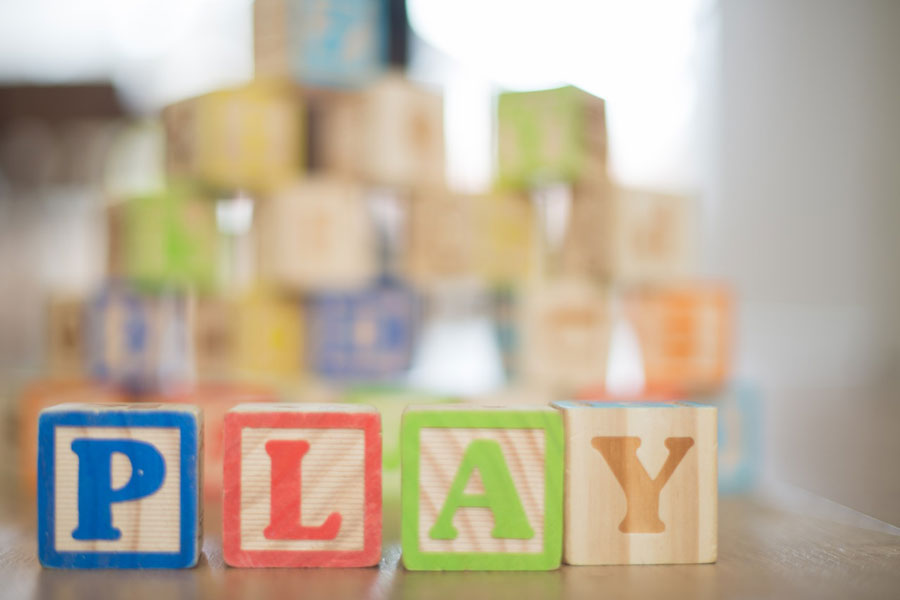 Building blocks that spell the word play